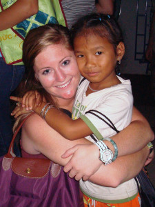 Amy DeVillez poses with a child at a Cambodian orphanage in spring 2010.